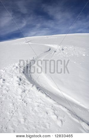 Snowmobile trail in snow.