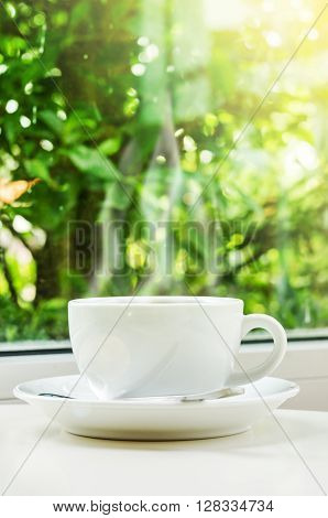 The morning coffee with day light on nature background.