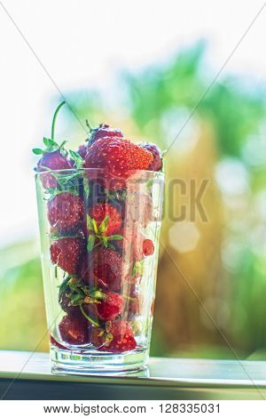 Fresh ripe strawberry in a glass