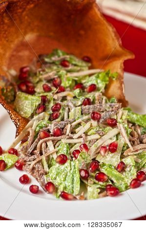 salad with meat  sauce and pomegranate