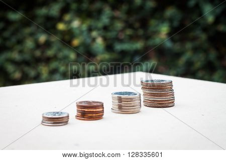 Money coin growing graph with green background, stock photo