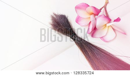 Bundle hair cut fasten put on blank note book with flower background