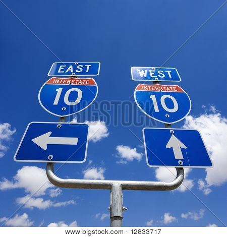 Highway interstate 10 sign with arrows pointing east and west.