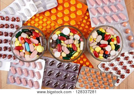 Colorful medical pills and capsules for therapy and blisters of tablets or supplements concept of treatment and health care