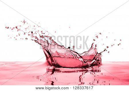 splashing red wine on white background