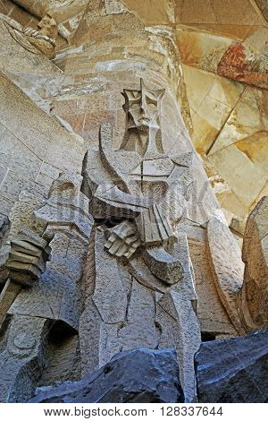 BARCELONA, SPAIN - AUGUST 3, 2015: Sculpture on the Passion facade of the basilica Sagrada Familia in Barcelona, Spain