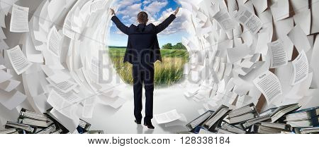 Office worker creates a passage in a paper Sea as Moses. Work hard businessman finds a solution to the problem.
