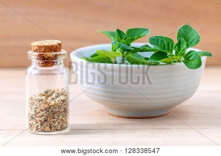 Fresh Oregano And Oregano Dried In A The Bottle With Shallow Depth Of Field Setup On Wooden Backgrou