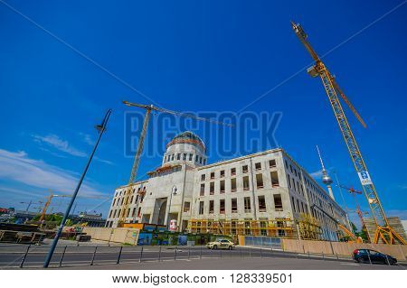 BERLIN, GERMANY - JUNE 06, 2015: Big cranes working on the reconstruction of Berlin city palace, historic buiding