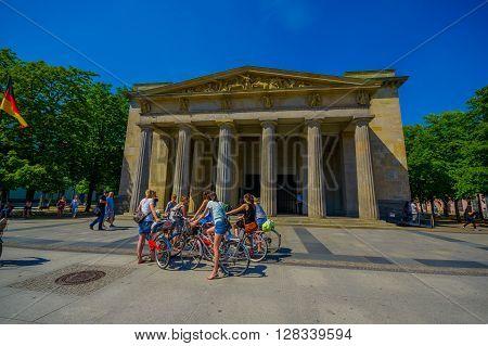 BERLIN, GERMANY - JUNE 06, 2015: Neue Wache museum in Berlin, unidentified cyclists outside ready to enter, war