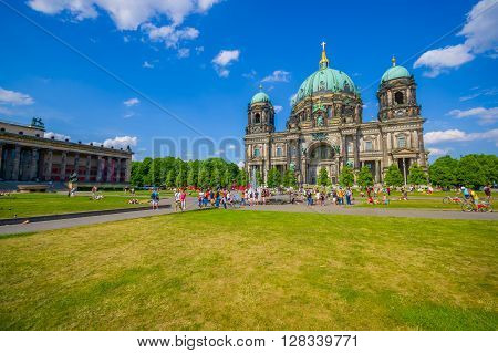 BERLIN, GERMANY - JUNE 06, 2015: Various turists and people visiting and taking a walk outside of Berlin Cathedral, historical and beautiful place