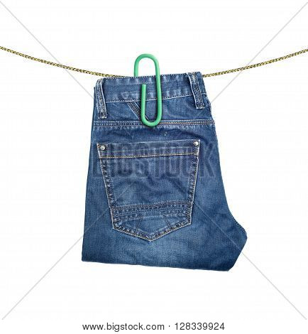 Folded jeans hanging on a clothesline. Conceptual photo