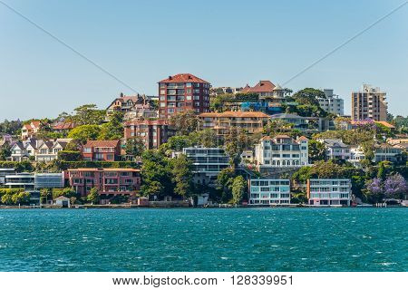 Sydney Australia - November 9 2014: The view of Sydney City Skyline - Point Piper mansions Sydney Australia. Point Piper is a small affluent harbourside eastern suburb of Sydney.