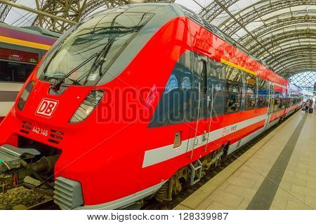 DESDREN, GERMANY - MARZO 23, 2016: Red HB train ready for departure, modern train and beautiful architecture