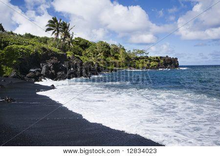 Black sand beach in Maui, Hawaii.