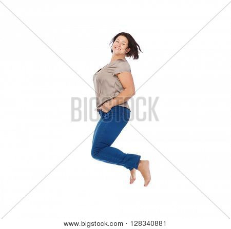 happiness, freedom, motion and people concept - smiling happy plus size woman jumping high in air