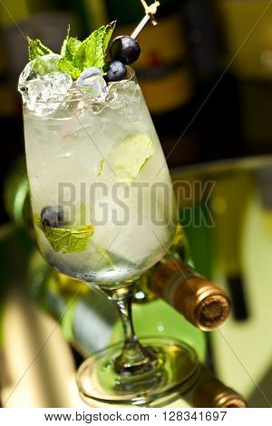 Cocktail with Vodka and White Wine, Grapes, Various Syrup, Lime Juice, Apple Juice and Mint