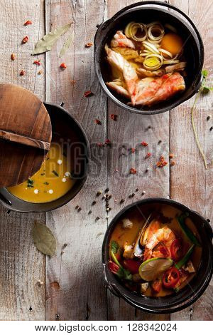 Seafood Soups on Wooden Background