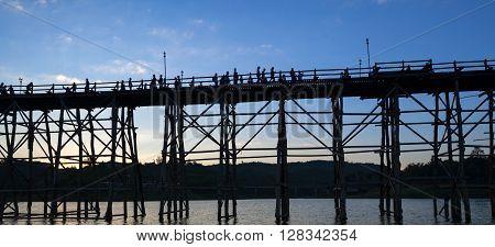 Silhouette Of Utamanusorn Bridge (mon Bridge), Made From Wooden For Across The River In Sangkhlaburi