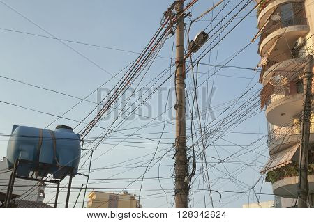 Entangled telecom and electric wires in the centre of Tirana Albania