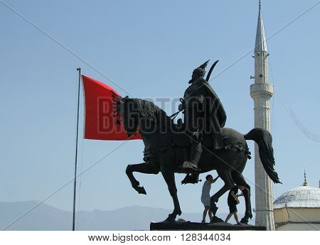 Skanderbeg's monument Tirana Albania Albanian national flag flying Ethem Bey Mosque minaret in the background