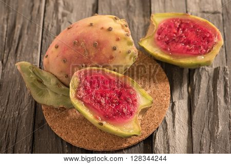 half prickly pear cactus on wooden panel ** Note: Shallow depth of field