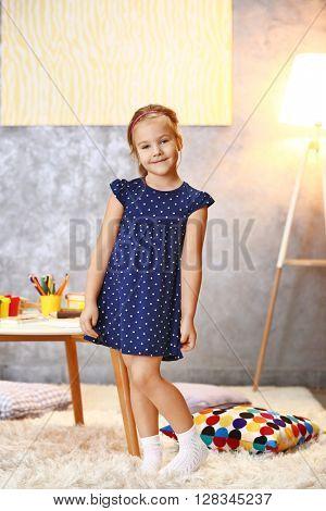 Beautiful small girl in light room