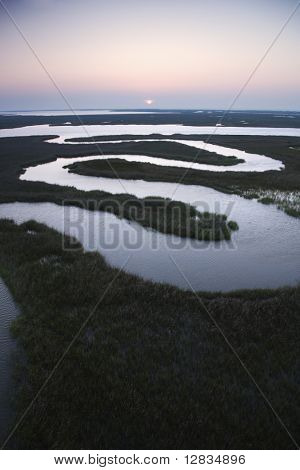 Aerial scenic view of winding waterway in marshland at Baldhead Island, North Carolina.