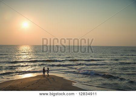 Birds eye view of couple on beach in Bald Head Island, North Carolina during sunset.
