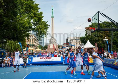 RIGA LATVIA - AUGUST 2: Street basketball players at tournament in front of Freedom monument. August 2015