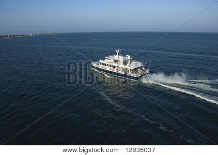 Aerial view of passenger ferry boat in open water near Bald Head Island, North Carolina.