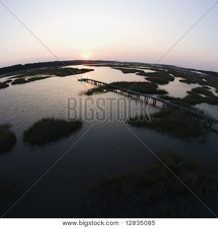 Aerial view of pier in coastal wetland on Bald Head Island, North Carolina.