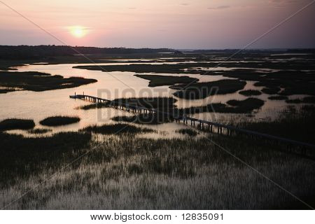 Aerial view of pier in coastal wetland on Bald Head Island, North Carolina.