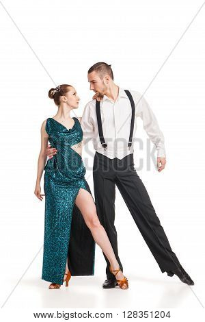 Beautiful two professional artists dancing over white background