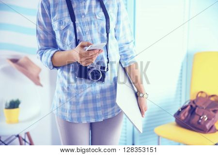 Blogging concept. Woman carrying a laptop.