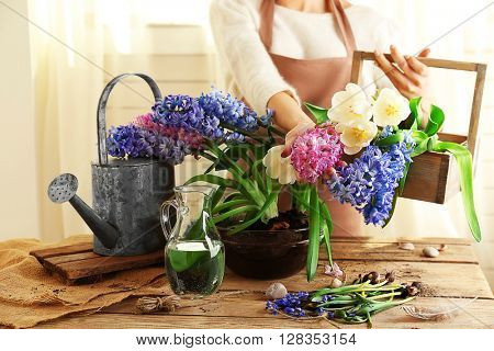 Woman and flowers indoors