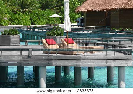 Water villas above blue ocean in Baros Maldives