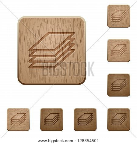 Set of carved wooden printing papers buttons in 8 variations.