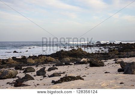The coast of Atlantic ocean near town Orzola on Lanzarote Canary islands Spain ** Note: Visible grain at 100%, best at smaller sizes