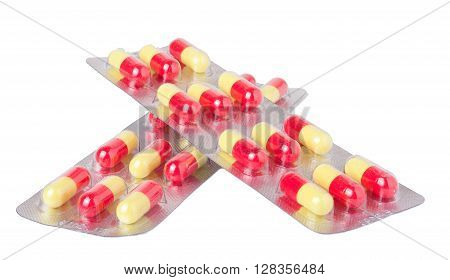 two packages with red and yellow pills on white background.