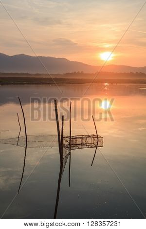 The fish trap in lake In the dawn light.