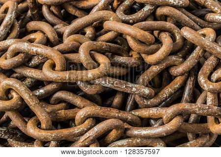 Old Rusty Chains Background/Close up of a rusty chains