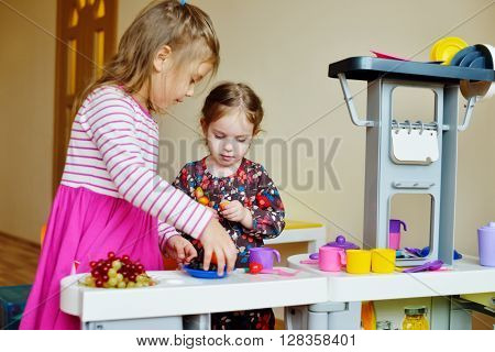 Children  Playing Toy Kitchen
