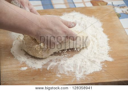 Women's Hands Preparing Fresh Yeast Dough