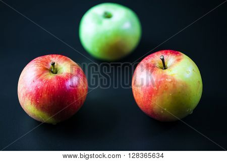 red apple isolated on a black background