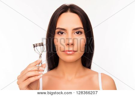 Close Up Portrait Of Serious Woman Holding Culer For Eyelashes