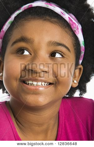 African American girl wearing headband looking to the side.