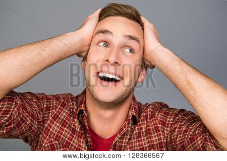 Close Up Photo Of Happy Glad Man Touching His Head