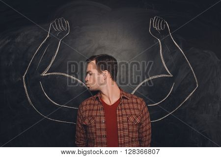 Attractive Young  Man Kissing His Drawn Biceps