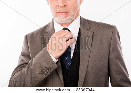 Close Up Photo Of Old Businessman Fastening His Tie